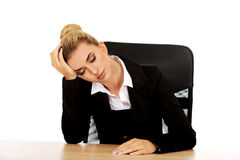 Tired young beautiful blonde businesswoman Stock Photography
