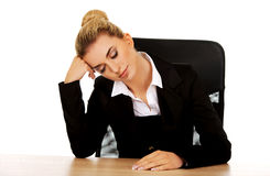 Tired young beautiful blonde businesswoman Stock Image