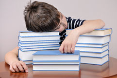 Tired young boy and books Royalty Free Stock Photo
