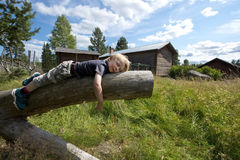 Tired young boy. Young boy on vacation taking a nap Royalty Free Stock Photo