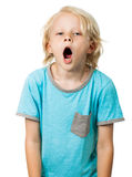 Tired young boy yawning Stock Photos