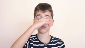 Tired young boy. Yawning and rubbing his eyes stock footage