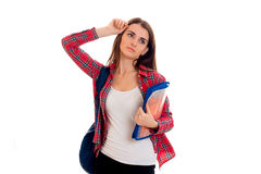 Tired young brunette student girl with blue backpack isolated on white background Royalty Free Stock Images