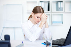 Tired young business woman Royalty Free Stock Images