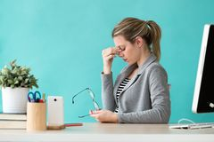 Tired Young Business Woman Having Headache While Working With Computer In The Office Stock Photo