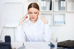 Tired young business woman with laptop computer Royalty Free Stock Photo