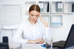 Tired young business woman with laptop computer Royalty Free Stock Photography