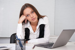 Tired young business woman Stock Images