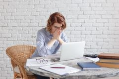Tired young business woman at work.  Royalty Free Stock Photo