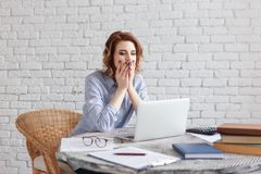 Tired young business woman at work. Tired young business woman at work Royalty Free Stock Images