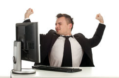 Tired young businessman with computer Royalty Free Stock Photos