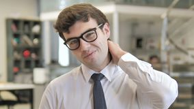 Tired young businessman with neck pain stock video