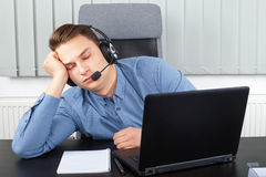 Tired young businessman at the office Stock Photography