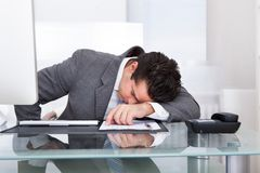 Tired young businessman Royalty Free Stock Photo