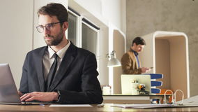 Tired Young Businessman During Work. Two career people in the office. Medium shot. Shot on RED Epic stock footage