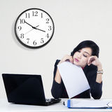 Tired young businesswoman Stock Photo