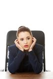 Tired young businesswoman at the office Royalty Free Stock Photos