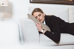 tired young businesswoman sleeping on sofa royalty free stock image