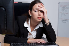 Tired young businesswoman under stres Royalty Free Stock Photography
