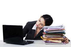 Tired young entrepreneur sleeping on documents Stock Image