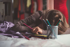 Tired Young Fashion Designer Royalty Free Stock Photo