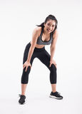 Tired young fitness woman after Squat exercise. On white background stock image