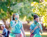 Tired Young Girls In Color Frenzy Fun Run. MACKAY, QUEENSLAND, AUSTRALIA - JUNE 2019: Unidentified young girls looking tired as they participate in Color Frenzy stock image