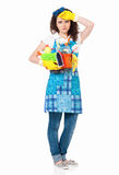 Tired young housewife with gloves Stock Photo