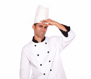 Tired young male cook standing with headache Stock Photography
