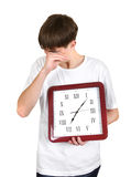 Tired Young Man with Big Clock Royalty Free Stock Photography