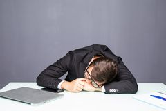 Tired young man fall sleeping in the office. Tired young man sleeping in the office Royalty Free Stock Photo