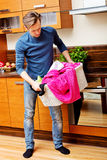 Tired young man with laundry basket Royalty Free Stock Photo
