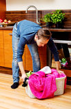 Tired young man with laundry basket Royalty Free Stock Image