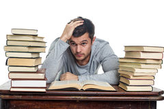 Tired young man reading book Royalty Free Stock Images