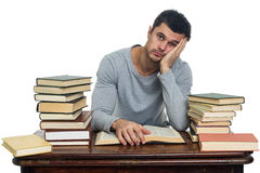 Tired young man reading book Stock Image