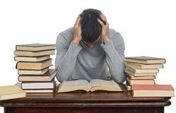 Tired young man reading book Stock Photo