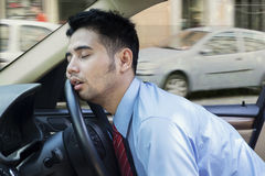 Tired young man sleeping inside the car Royalty Free Stock Images