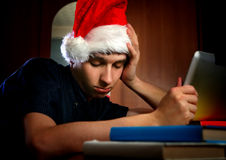 Tired Young Man with Tablet Royalty Free Stock Image