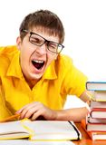 Tired Student Yawning. Tired Young Man Yawning with a Books Isolated on White Background Stock Photography