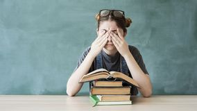 Tired young student girl with books. Tired young student girl with  books stock image
