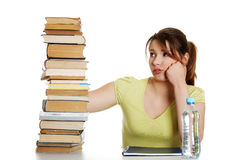 Tired young student woman at the desk Royalty Free Stock Photo