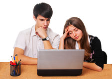 Tired young students studying  isolated over white. Two tired young students studying - isolated over white background Royalty Free Stock Images