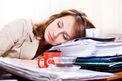 Tired young woman. Sleeping on the table Royalty Free Stock Photography
