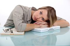 Tired young woman. In her office Stock Photography