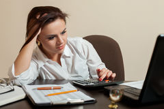 Tired young woman accountant concept Royalty Free Stock Photo