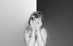Tired young woman. Tired young blond woman black and white sepia style Royalty Free Stock Images