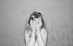 Tired young woman. Tired young blond woman black and white sepia style Royalty Free Stock Photo