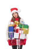 Tired young woman carrying many gifts Royalty Free Stock Photos