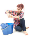 Tired young woman cleaning floor Stock Image
