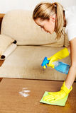 Tired young woman cleaning table in yellow gloves Royalty Free Stock Photos